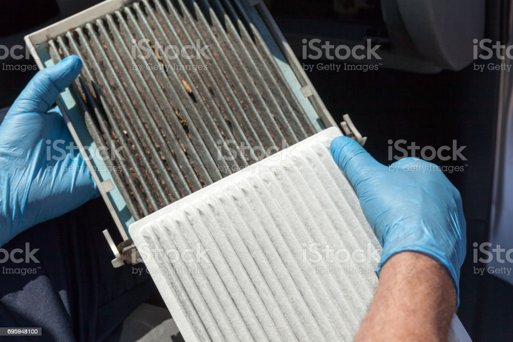 Clean and dirty cabin air filter for car stock photo