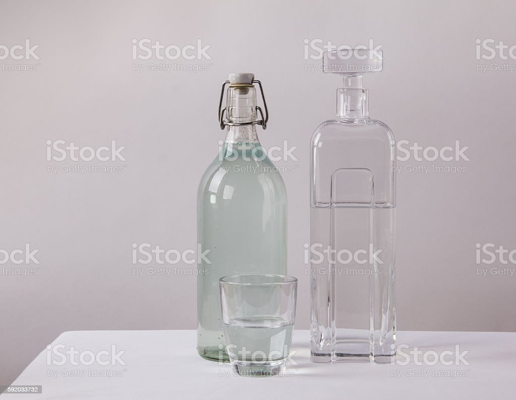 Clean and dirty drinking water-concept stock photo