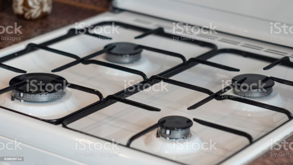 Clean and neat white gas stove stock photo