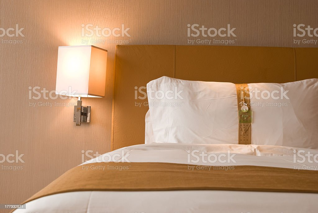clean and tidy bed in a hotel room royalty-free stock photo