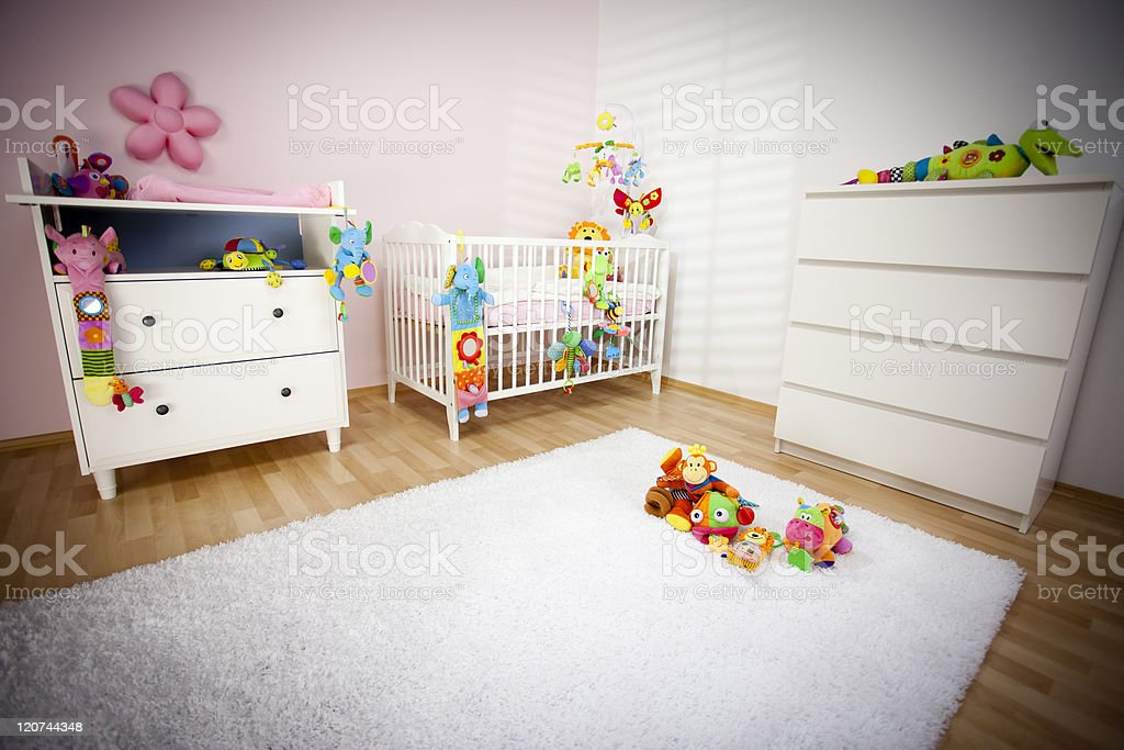 A clean and tidy nursery room awaiting a newborn baby stock photo