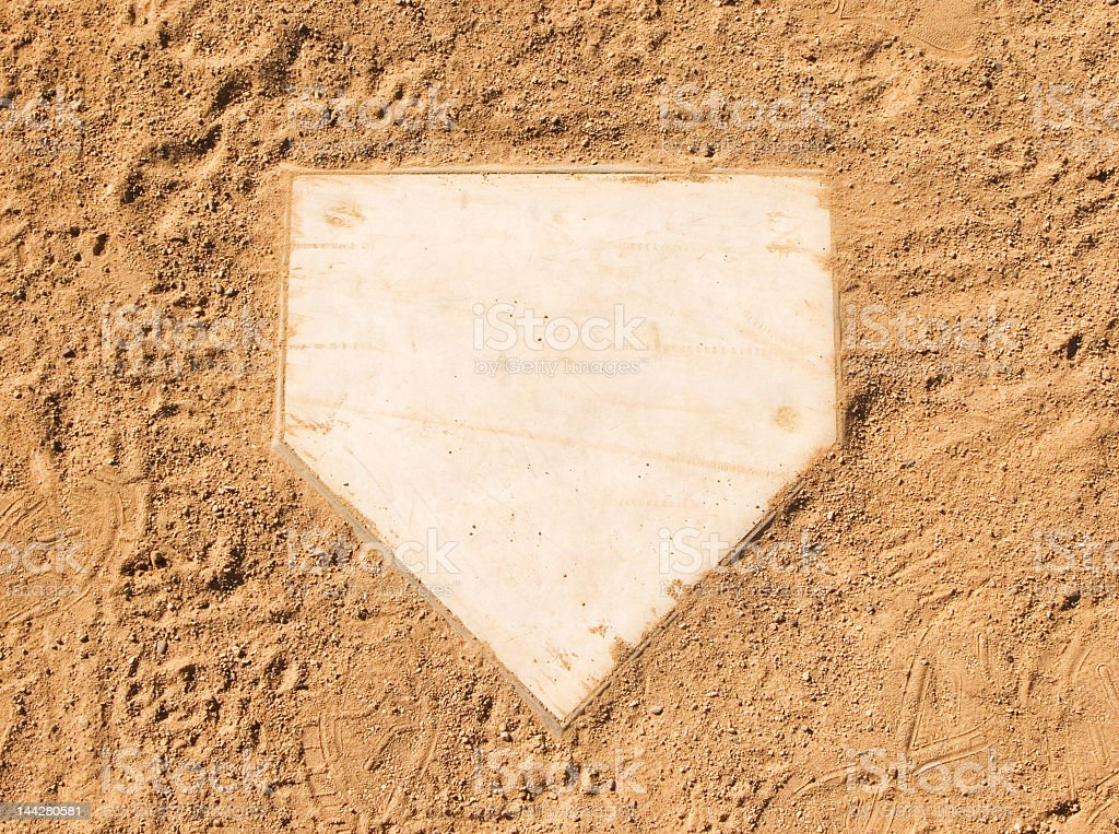 Clean baseball home plate set in dirt royalty-free stock photo