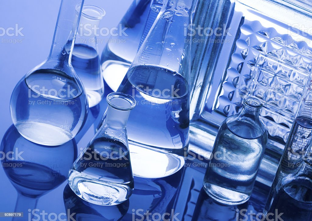 Clean beakers full of purified water for a sterile workplace stock photo