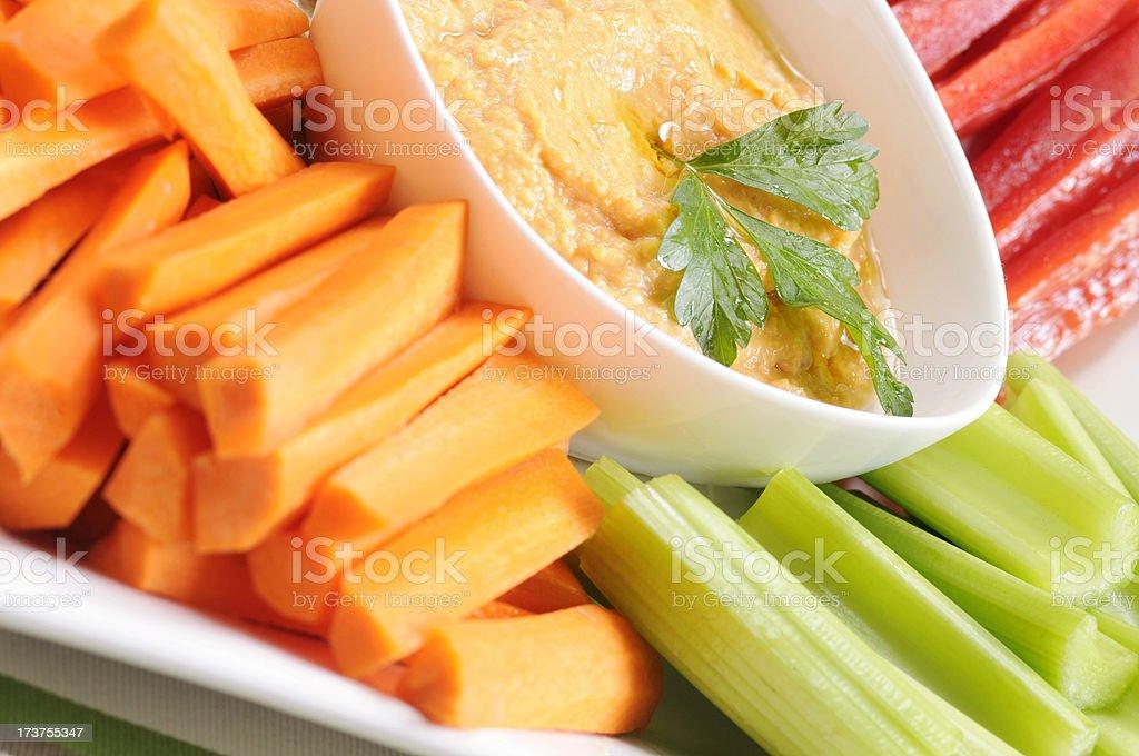 Clean Eating Series: Fresh Veggies and Red Pepper Hummus stock photo