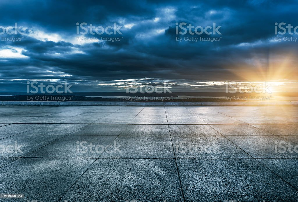 clean empty brick floor with seattle skyline at night stock photo