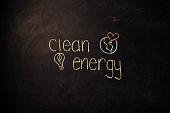 TEXT Clean Energy against black backdrop - Illustration