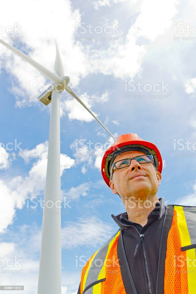 Clean Energy Worker and Wind Mill stock photo