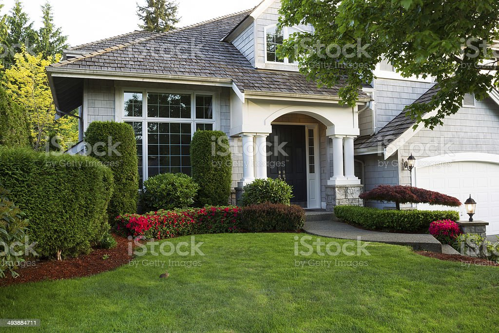 Clean exterior home during late spring season stock photo