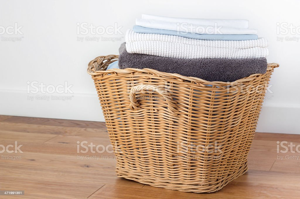 Clean folded laundry in a basket stock photo