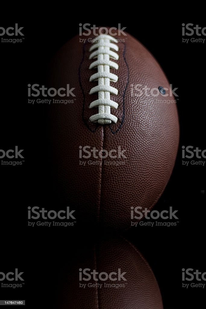 Clean football on black background royalty-free stock photo