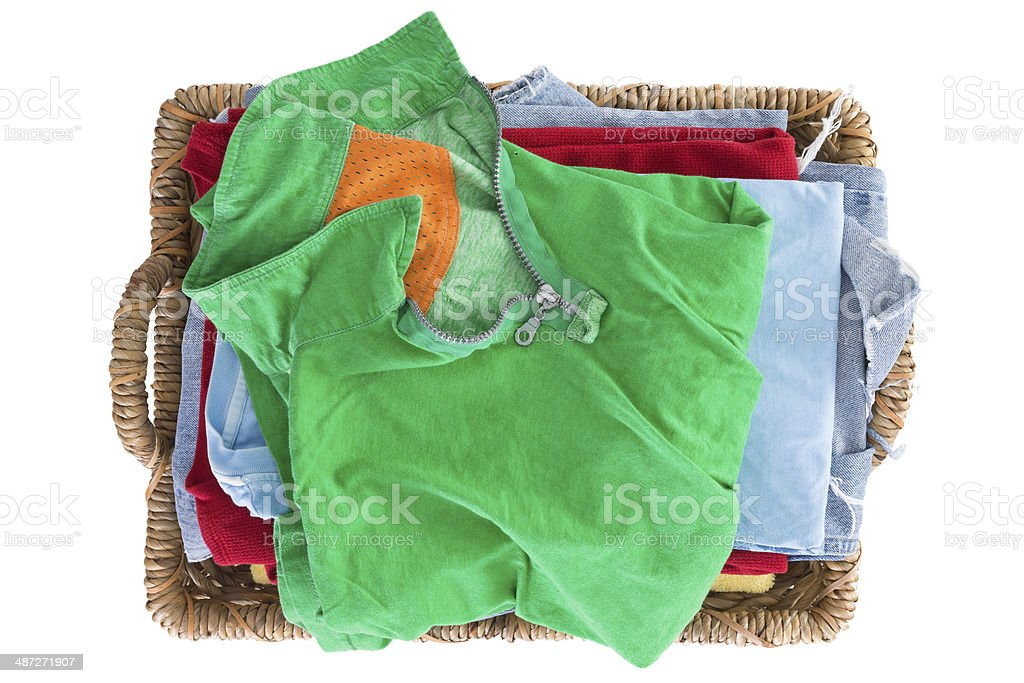 Clean fresh washed summer clothes in a basket stock photo