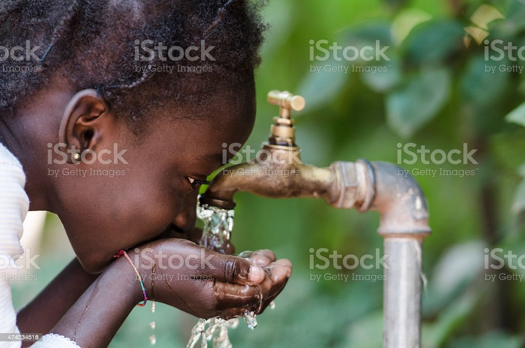 Clean Fresh Water Scarcity Symbol: Black Girl Drinking from Tap stock photo