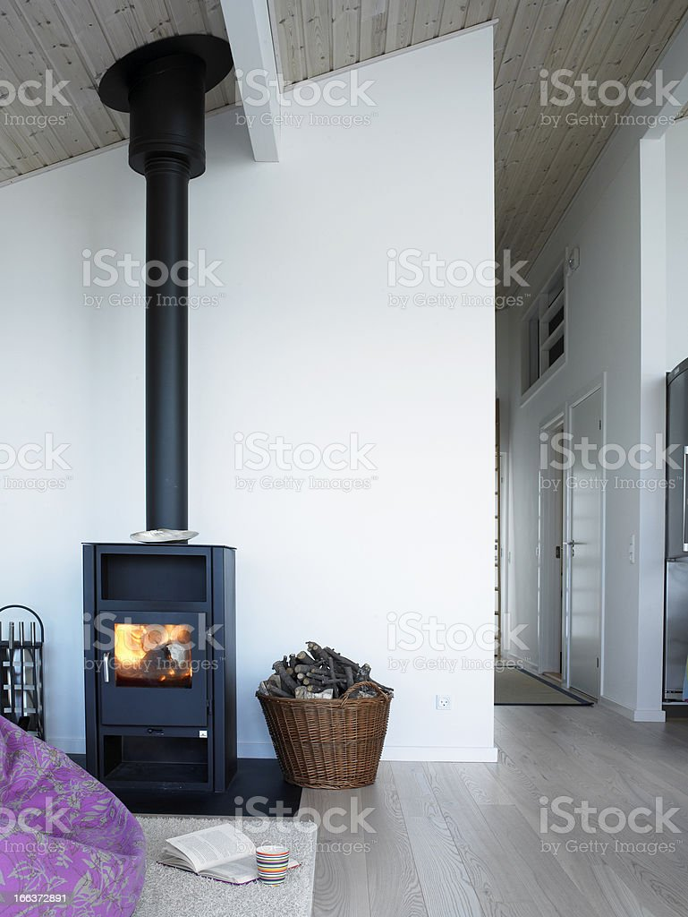 Clean home with wood stove stock photo