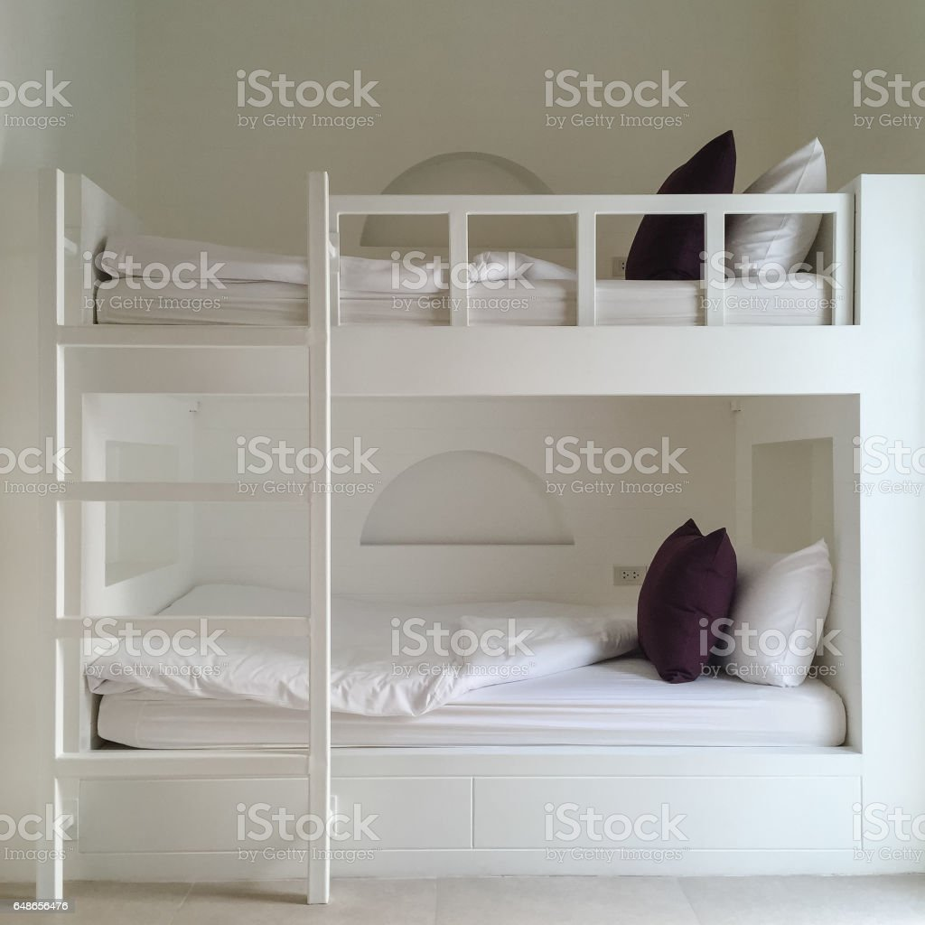 Clean hostel room with wooden bunk beds. stock photo