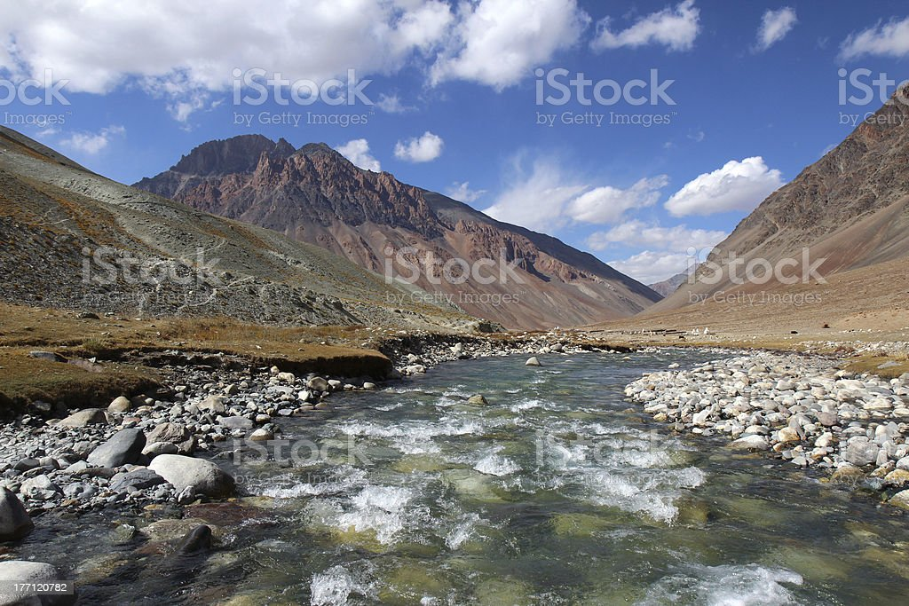 clean ice river high in himalayan mountains stock photo