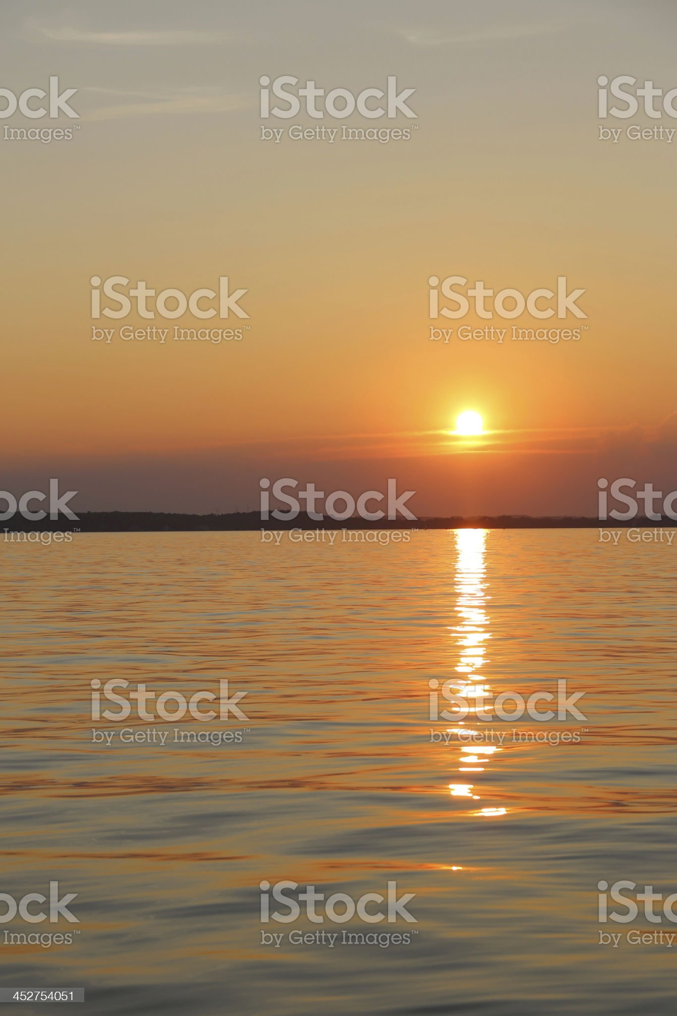 Clean lake at sunset vertical royalty-free stock photo