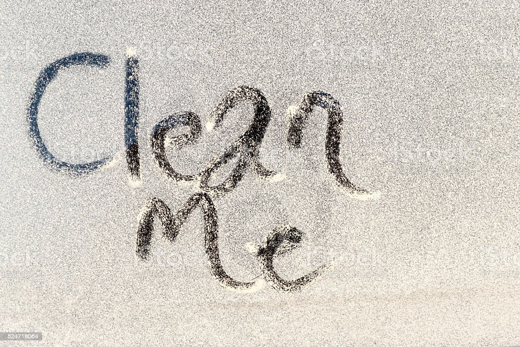 Clean Me Text on Dirty Window stock photo