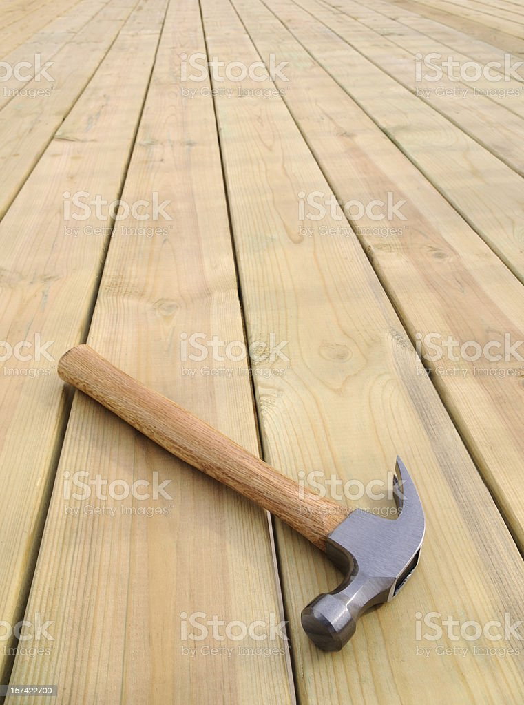 Clean New Building Construction, Patio Deck Floor Surface with Hammer royalty-free stock photo