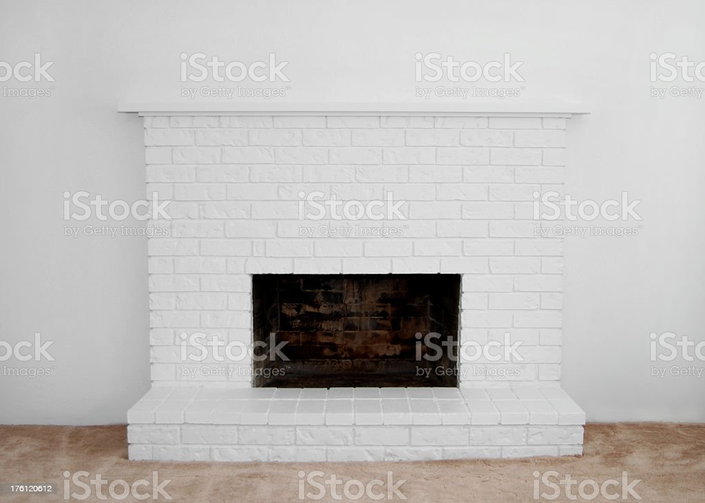 Clean, plain, white brick fireplace royalty-free stock photo
