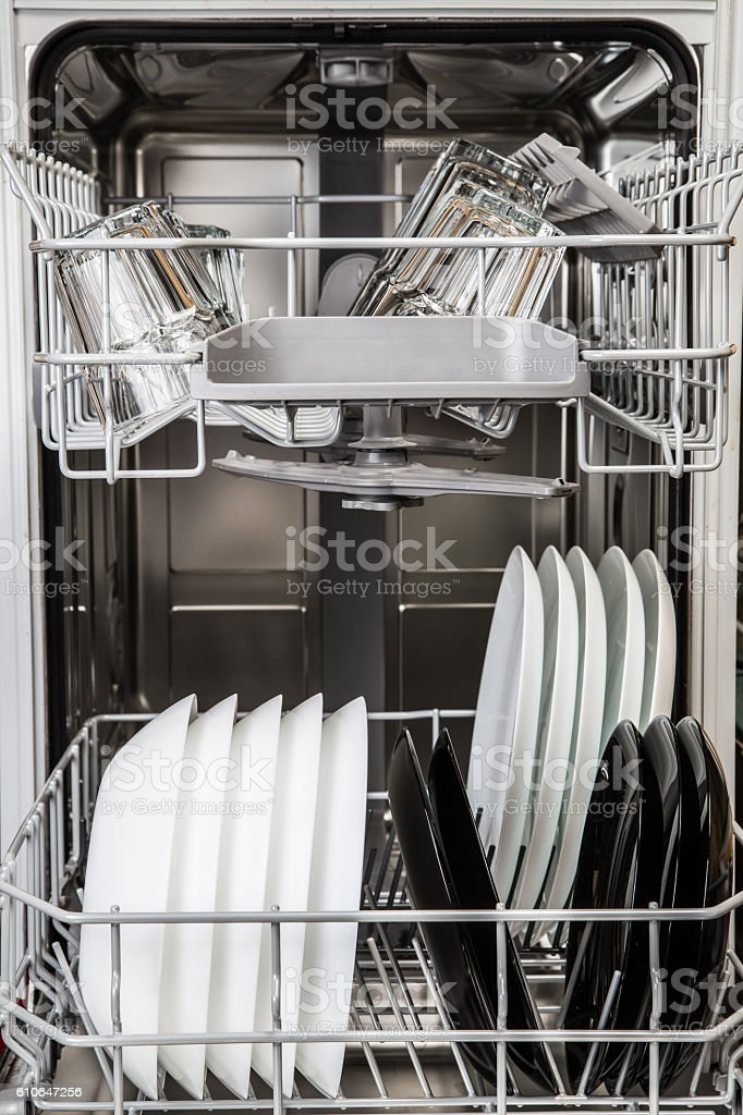 Clean plates and glasses in dishwasher machine stock photo