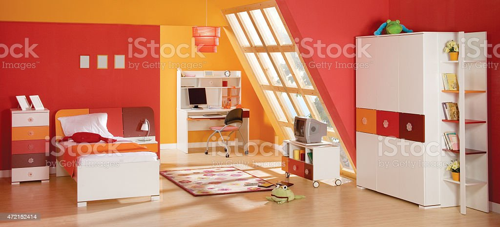 Clean red and orange modern kids bedroom stock photo