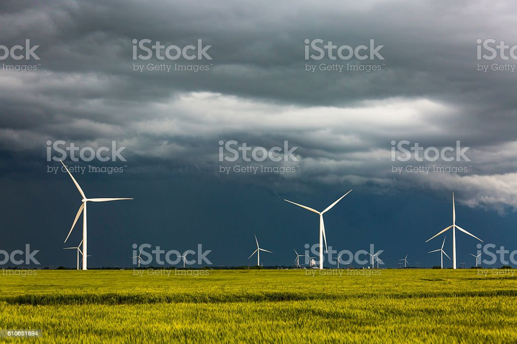 Clean, renewable energy wind turbines in severe thunderstorm stock photo