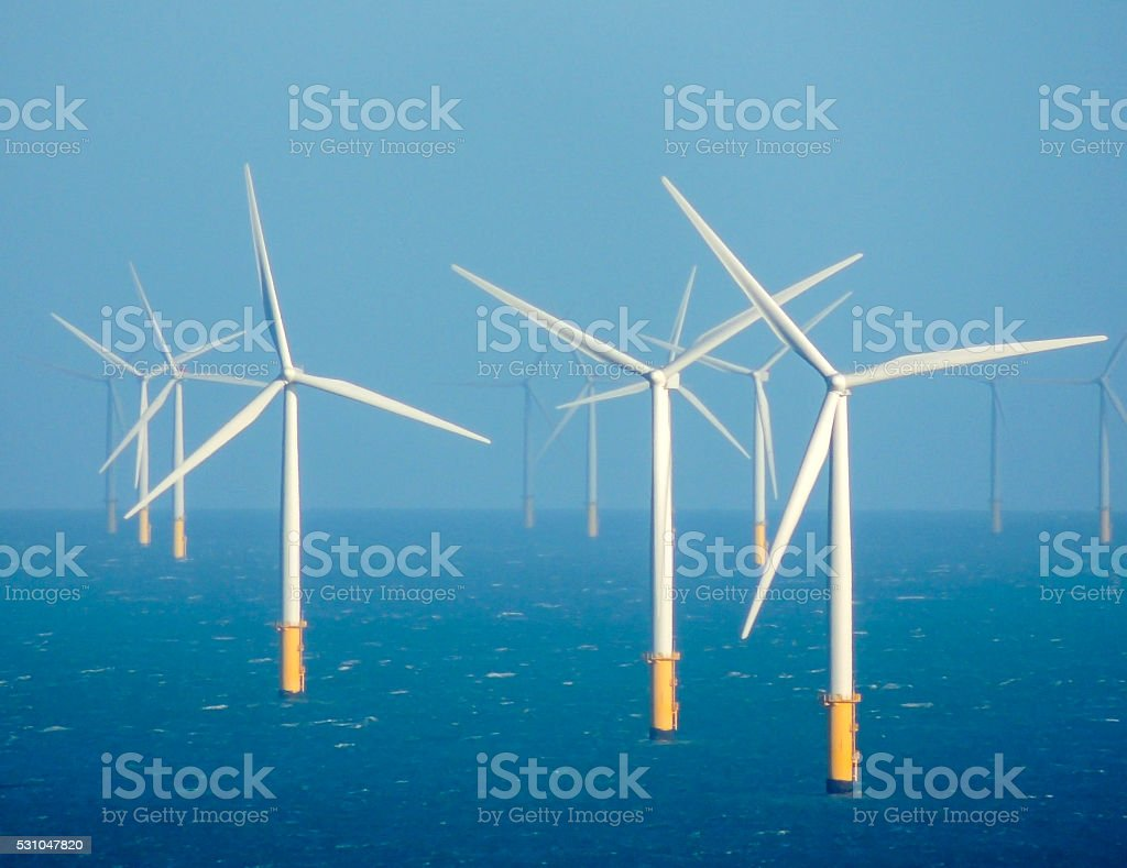 Clean sustainable energy - wind turbines in the sea stock photo