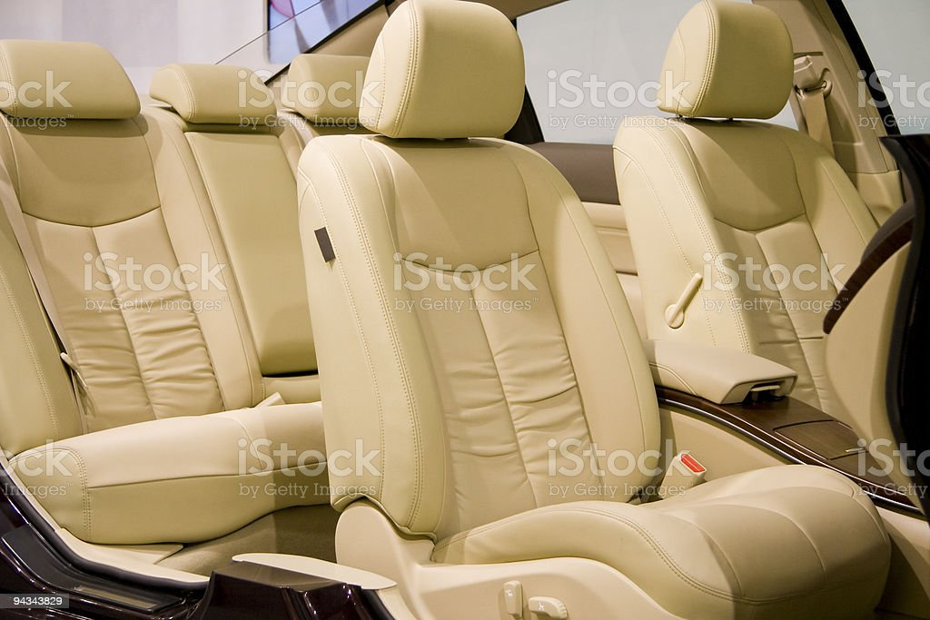 Clean, tan, leather, front and back car seats royalty-free stock photo