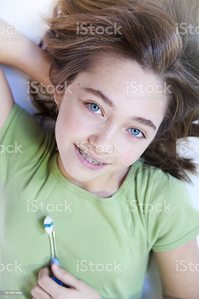 Clean teeth with braces serie stock photo