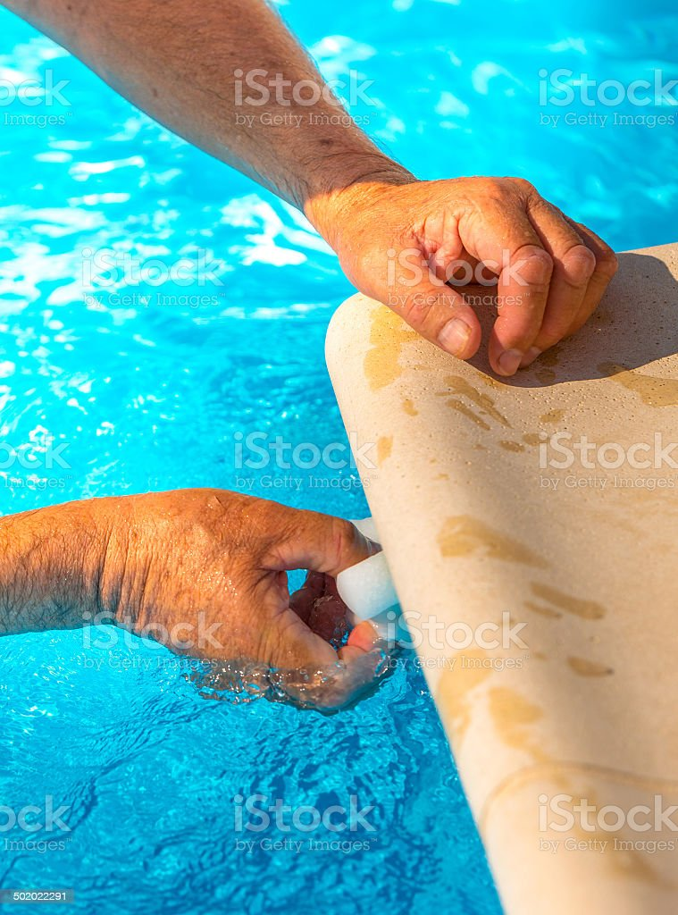 Clean the water line of a pool royalty-free stock photo