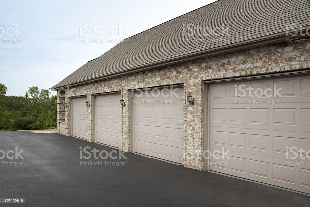 Clean Tidy Brick Four Stall Garage Attached to House royalty-free stock photo