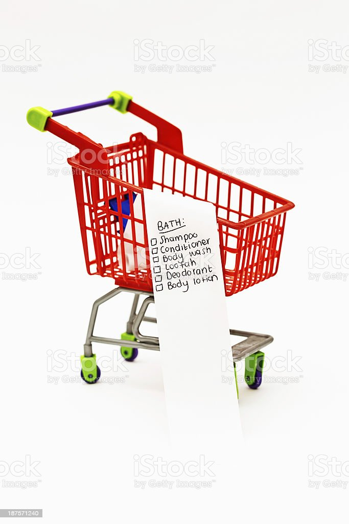 Clean up with this bathtime shopping list in tiny trolley! stock photo