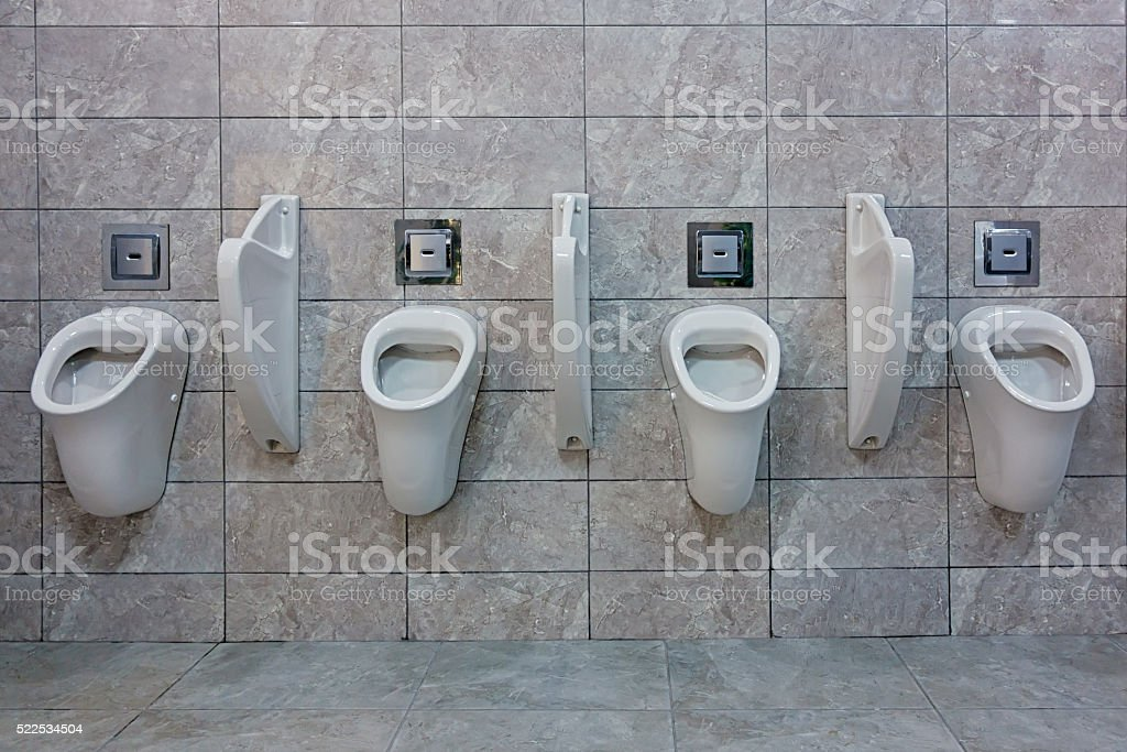 Clean Urinals in toilet stock photo
