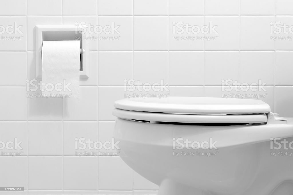 Clean, white bathroom toilet with the lid closed stock photo