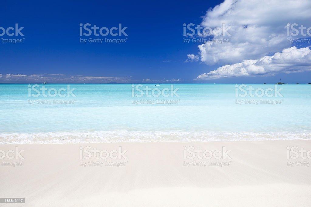 Clean White Caribbean Beach With Blue Sky stock photo