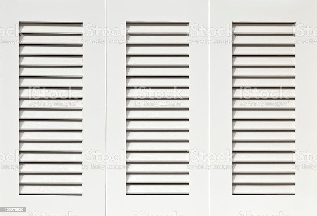 Clean white shutters ready for installation stock photo