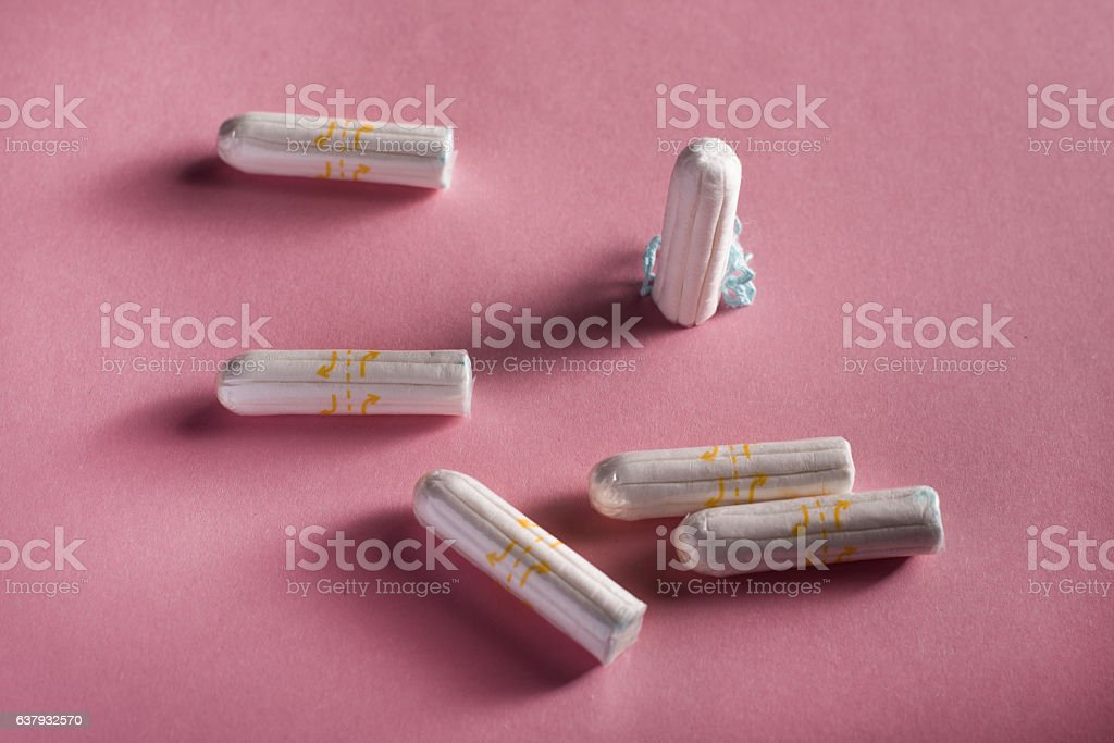 Clean white tampons on pink background stock photo