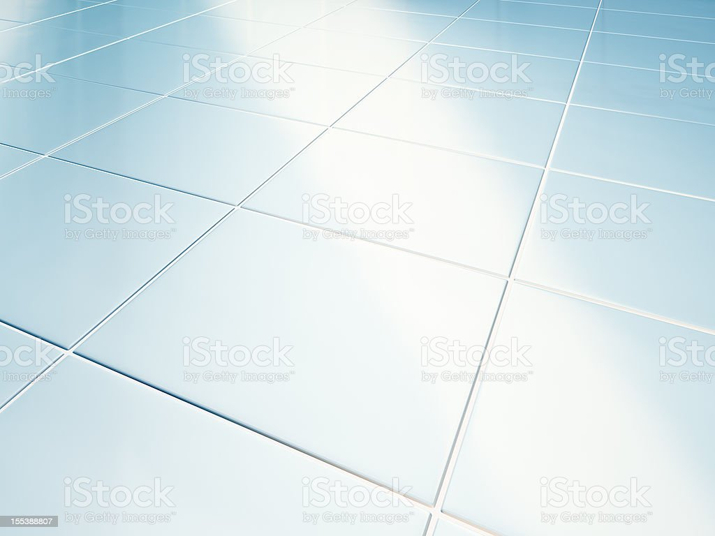 Clean white tiled floor in bathroom stock photo