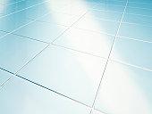 Clean white tiled floor in bathroom
