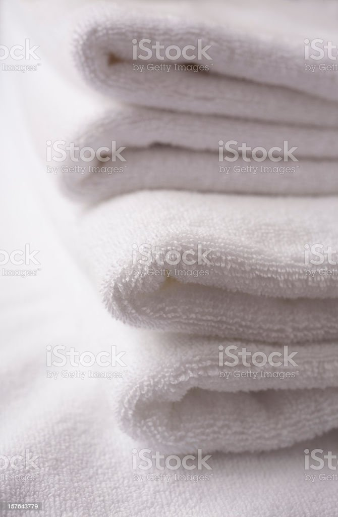 Clean white towels folded in a pile stock photo