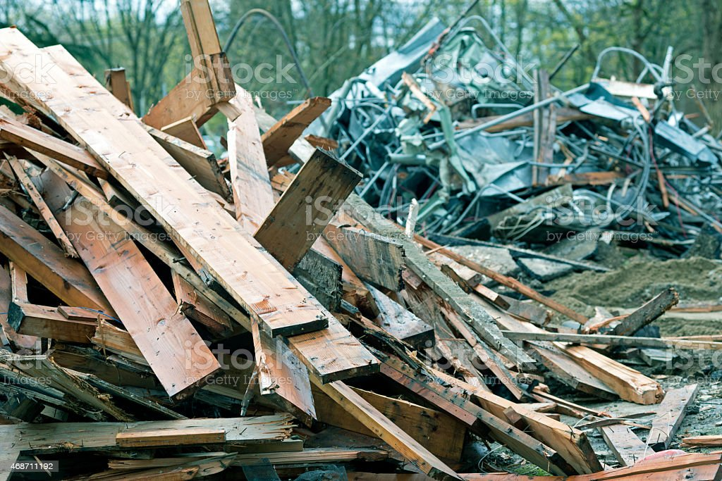 Clean wood and scrap metal at demolition site stock photo