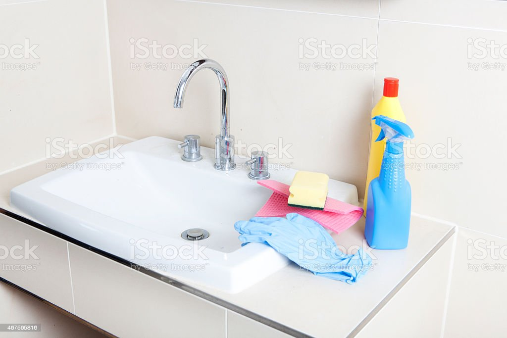 Cleaner and wash basin stock photo