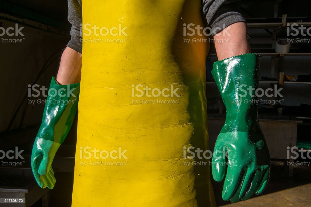 Cleaner man standing in factory stock photo