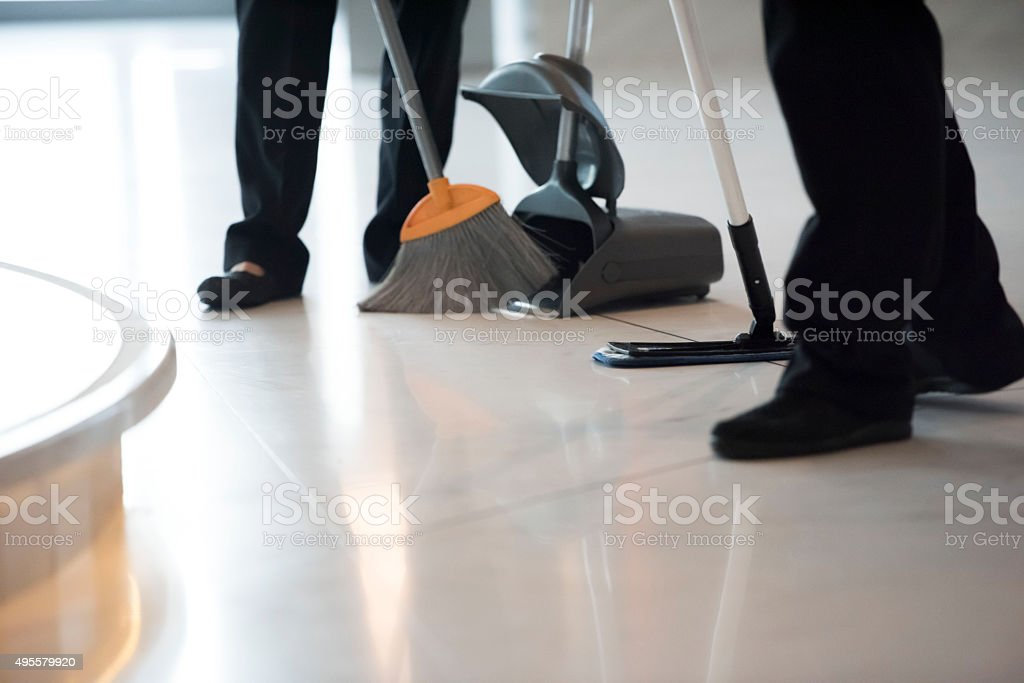 Cleaners are mopping the office stock photo