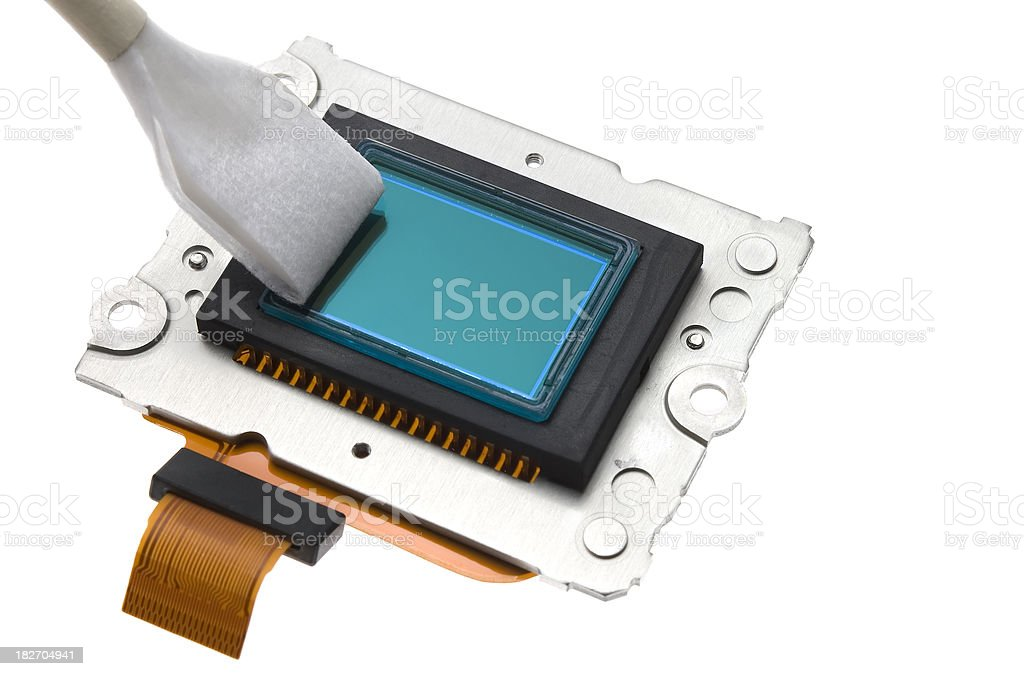 cleaning a camera sensor stock photo