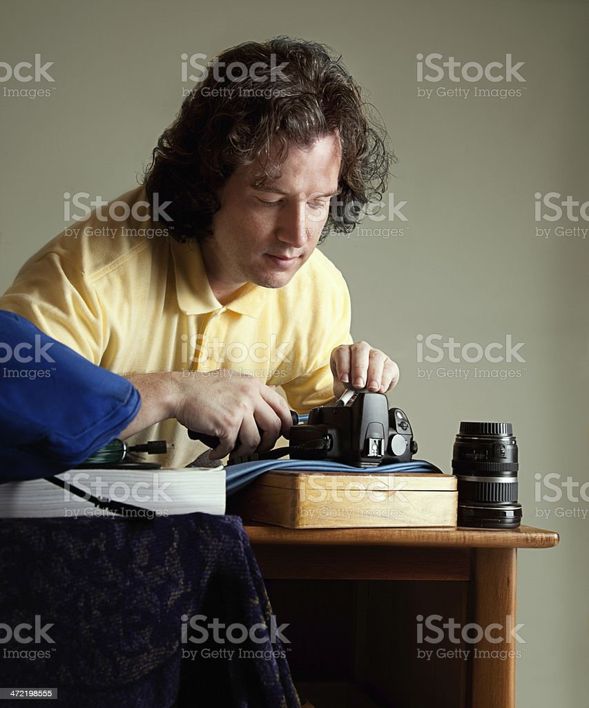 Cleaning a DSLR camera stock photo