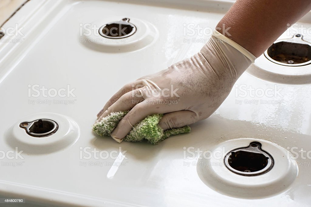 Cleaning a gas stove stock photo