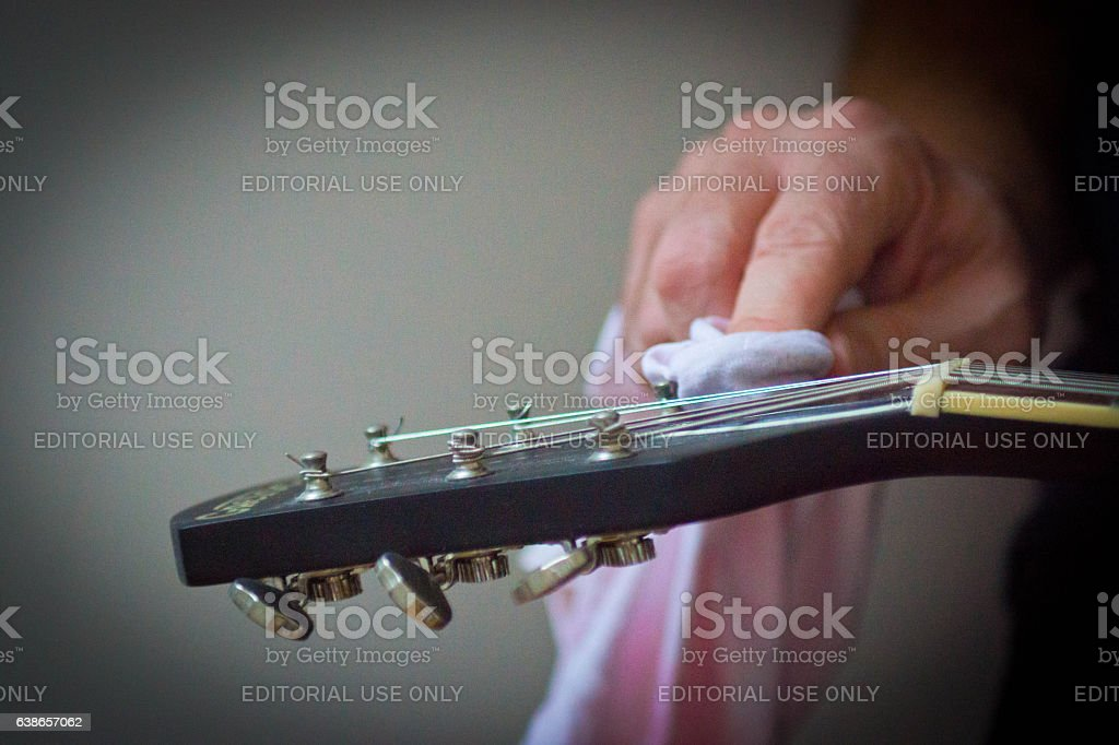 Cleaning a guitar machine head stock photo