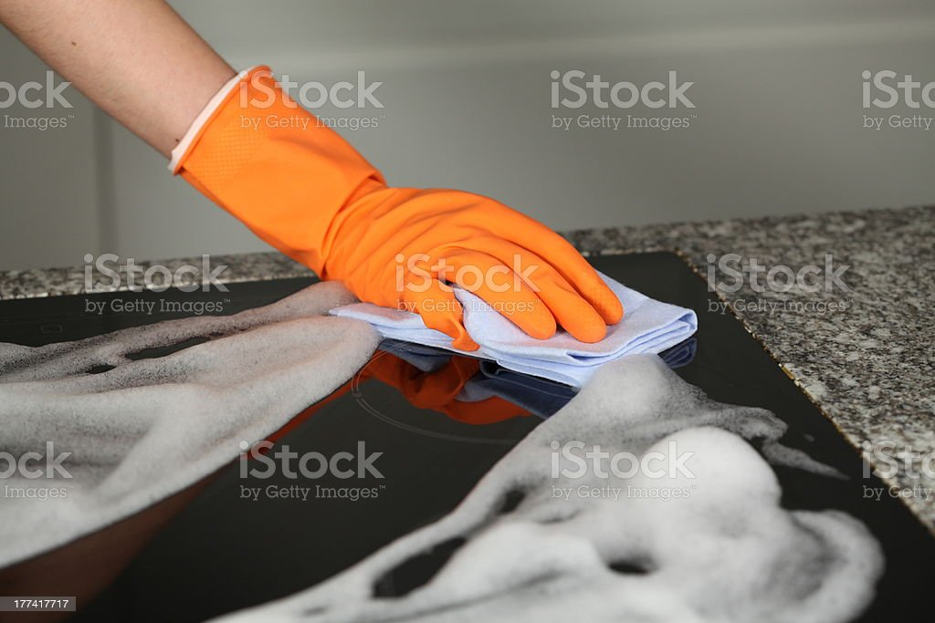 Cleaning a kitchen royalty-free stock photo