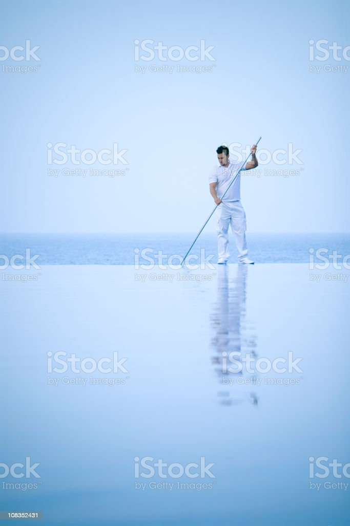 Cleaning a pool at dawn royalty-free stock photo